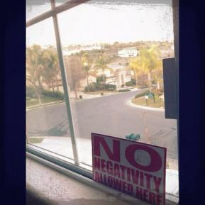 No Negativity Allowed Here sign and the view from my window